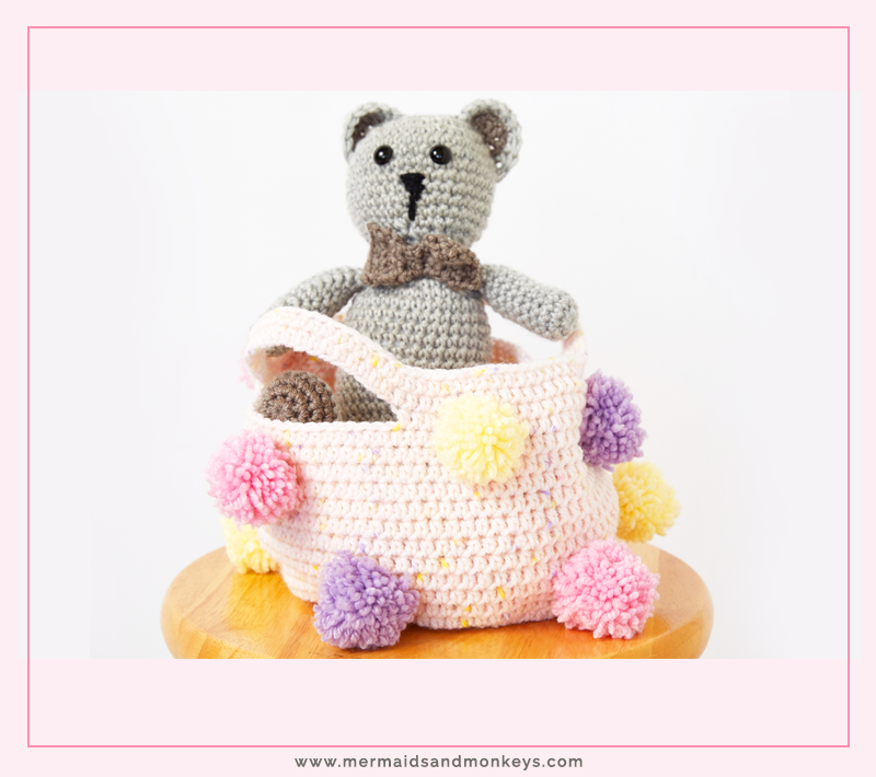 If you're looking for an easy way to create more storage for a room, this Pom Pom Storage Basket is perfect. #crochetbasket #crochetpattern #crochetlove #crochetaddict