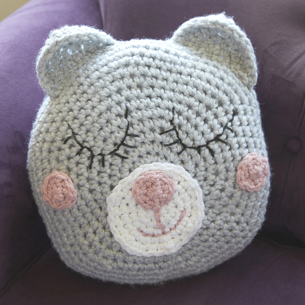 This Sleepy Teddy Pillow is the perfect crossover between a pillow and a stuffed animal. #crochetpillow #crochetcushion #crochetpattern #crochetlove #crochetaddict