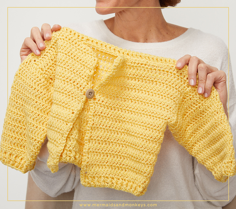This crochet sweater is perfect to wear to Easter dinner or to hunt eggs at the local park. Your little one will love this free crochet pattern. #KidsCrochetSweater #CrochetCardigan #CrochetPattern #CrochetAddict