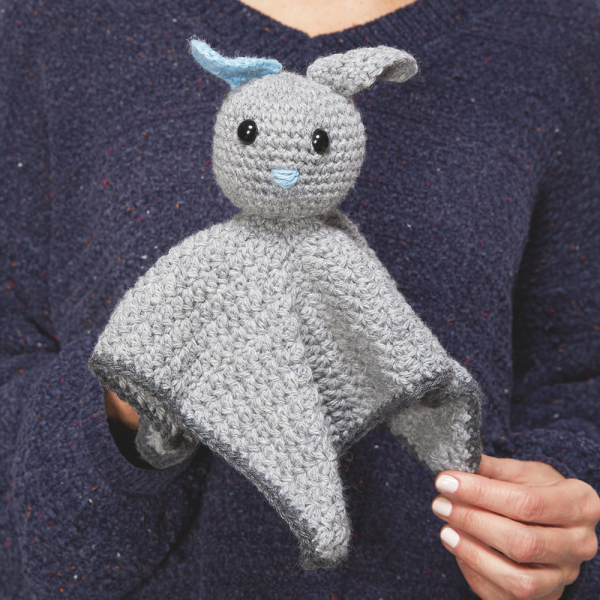 This bunny comforter crochet pattern is so sweet and such a creative take of baby blankets. This is the perfect little friend for a newborn baby. #CrochetBlanket #CrochetComforter #CrochetBabyBlanket #BabyBlanket