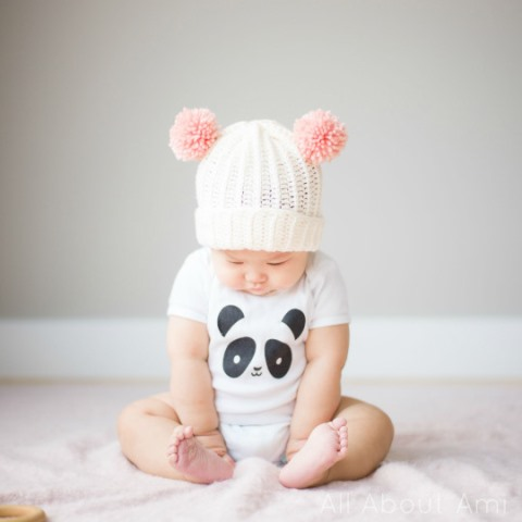 Bear Pom Beanie - If you're in a rush, these free crochet baby hat patterns are perfect for showing how much you really care, without taking a month to complete. #crochetbabyhatpattern #crochethat #crochetpattern #crochetbabybeanie #crochetaddict
