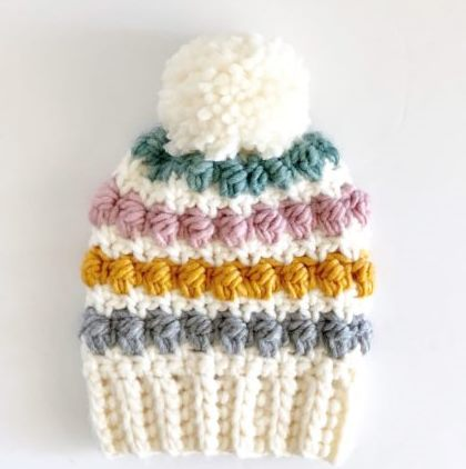 Crochet Even Berry Stitch Hat - If you're in a rush, these free crochet baby hat patterns are perfect for showing how much you really care, without taking a month to complete. #crochetbabyhatpattern #crochethat #crochetpattern #crochetbabybeanie #crochetaddict