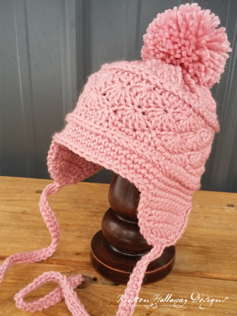 La Vie en Rose Ear Flap Hat - If you're in a rush, these free crochet baby hat patterns are perfect for showing how much you really care, without taking a month to complete. #crochetbabyhatpattern #crochethat #crochetpattern #crochetbabybeanie #crochetaddict