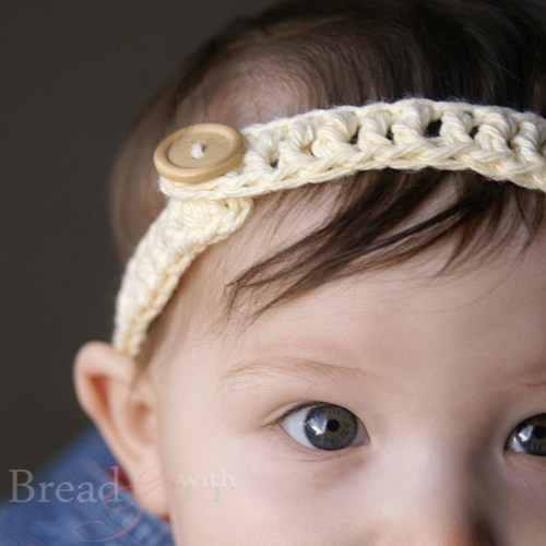 Baby Button Headband - This list of unique crochet baby headbands for girls are sweet and simple. You can whip these free crochet patterns up in no time, and there are so many options. #CrochetBabyHeadbands #BabyHeadbandPatterns #FreeCrochetPattern
