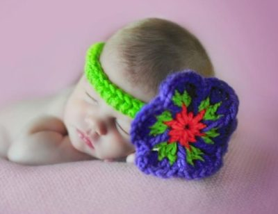 Baby's Favorite Flower Headband - This list of unique crochet baby headbands for girls are sweet and simple. You can whip these free crochet patterns up in no time, and there are so many options. #CrochetBabyHeadbands #BabyHeadbandPatterns #FreeCrochetPattern