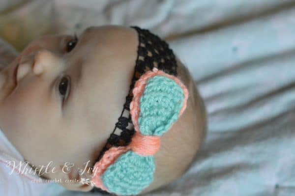 Double Bow Headband - This list of unique crochet baby headbands for girls are sweet and simple. You can whip these free crochet patterns up in no time, and there are so many options. #CrochetBabyHeadbands #BabyHeadbandPatterns #FreeCrochetPattern