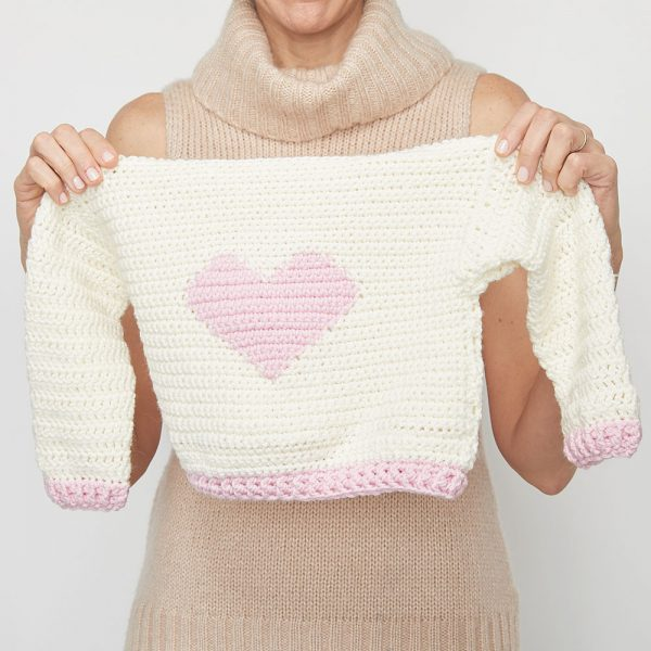 If you want to crochet for kids in your life, this little crochet sweater will make a great project. Start having fun with the Children's Heart Sweater. #CrochetSweater #CrochetSweaterPatterns #CrochetingForBeginners