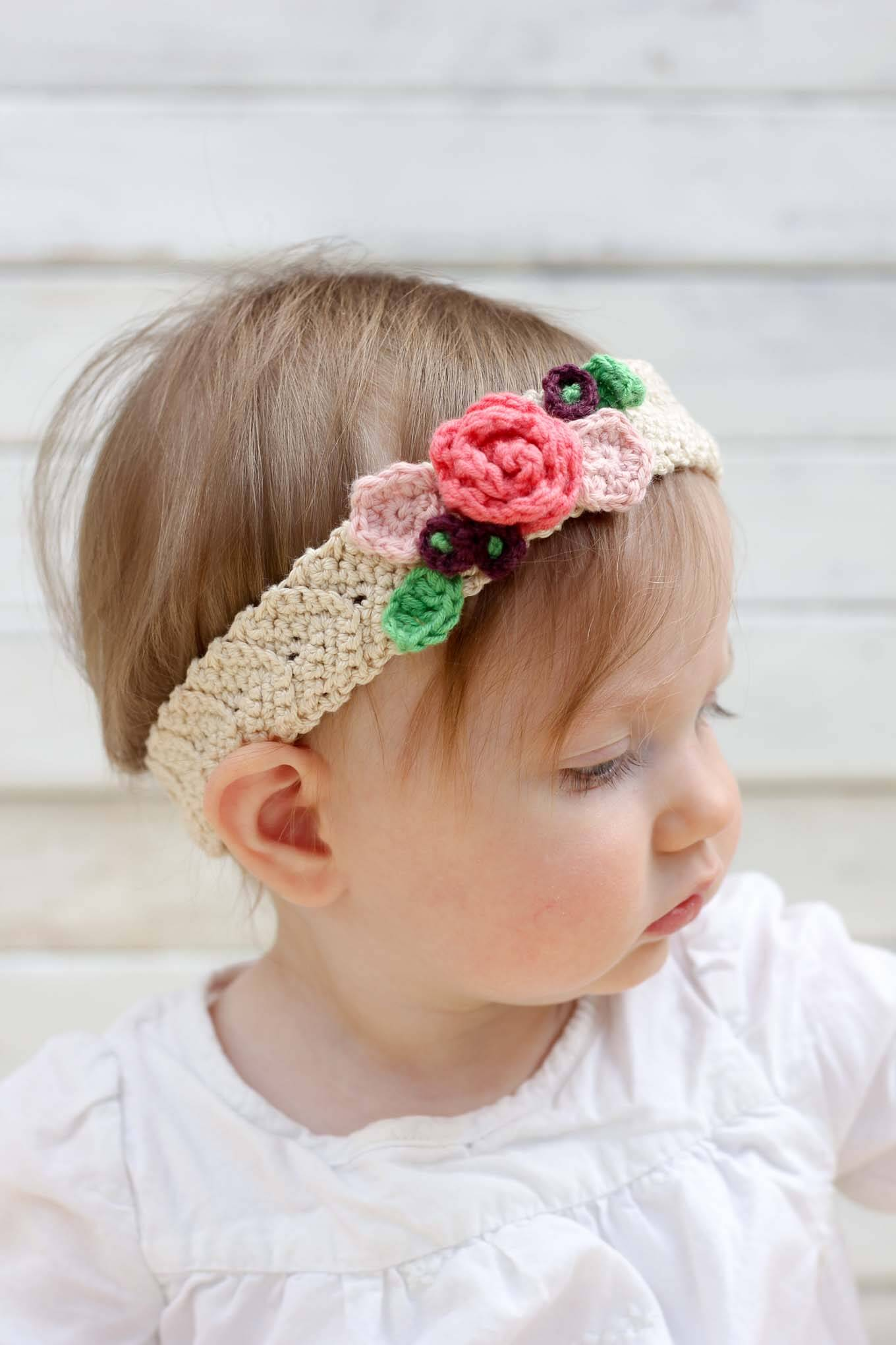 Spring Has Sprung Flower Headband - This list of unique crochet baby headbands for girls are sweet and simple. You can whip these free crochet patterns up in no time, and there are so many options. #CrochetBabyHeadbands #BabyHeadbandPatterns #FreeCrochetPattern
