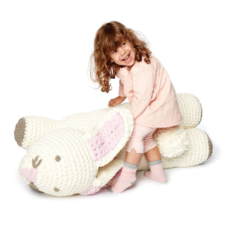 Bunny Floor Pillow - These crochet pillows are fun and an adventure to make. If you're looking for creative kids pillows, this list will be your go to. #CrochetPillowPatterns #CrochetPatterns #CrochetAddict