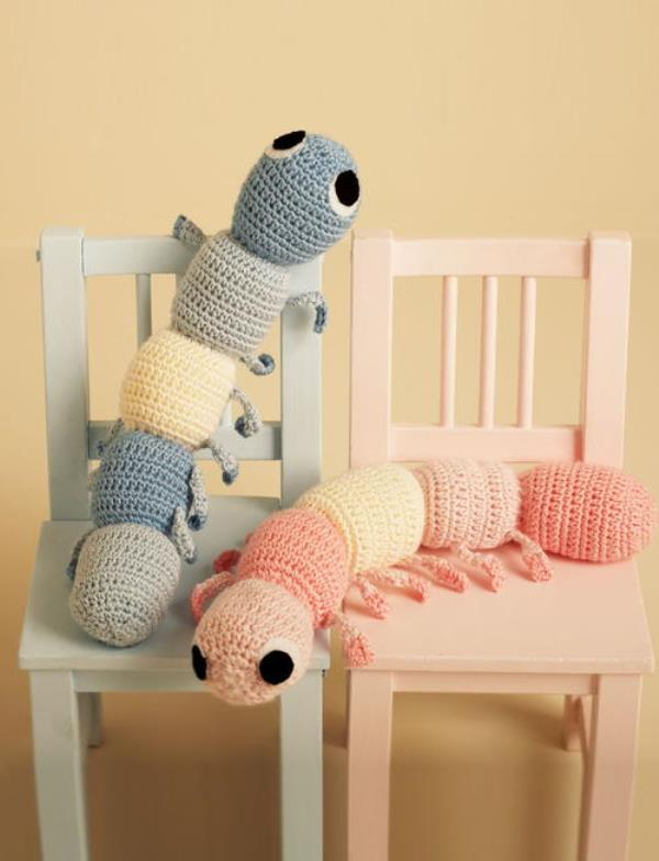 Caterpillar Cuddle Buddy - These crochet pillows are fun and an adventure to make. If you're looking for creative kids pillows, this list will be your go to. #CrochetPillowPatterns #CrochetPatterns #CrochetAddict