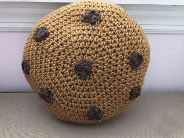 Cookie Pillow - These crochet pillows are fun and an adventure to make. If you're looking for creative kids pillows, this list will be your go to. #CrochetPillowPatterns #CrochetPatterns #CrochetAddict