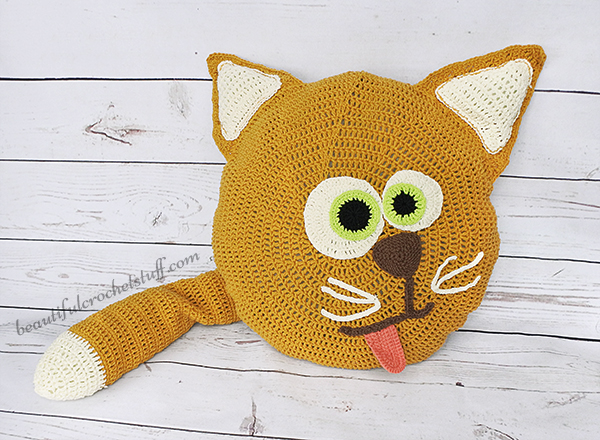 Crochet Cat Pillow - These crochet pillows are fun and an adventure to make. If you're looking for creative kids pillows, this list will be your go to. #CrochetPillowPatterns #CrochetPatterns #CrochetAddict