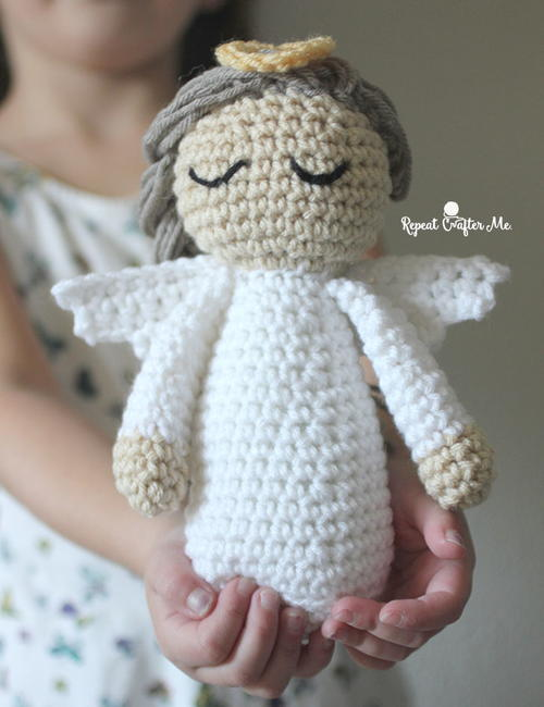 Divine Crochet Angel - These free crochet doll patterns are a mix of amigurumi patterns and other techniques. Create your own world with dolls that will take you on a journey. #AmigurumiPatterns #CrochetDollPatterns #FreeCrochetPatterns