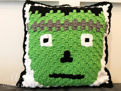 Frankenstein Pillow - These crochet pillows are fun and an adventure to make. If you're looking for creative kids pillows, this list will be your go to. #CrochetPillowPatterns #CrochetPatterns #CrochetAddict