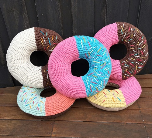 Crochet Donut Cushions - These crochet pillows are fun and an adventure to make. If you're looking for creative kids pillows, this list will be your go to. #CrochetPillowPatterns #CrochetPatterns #CrochetAddict