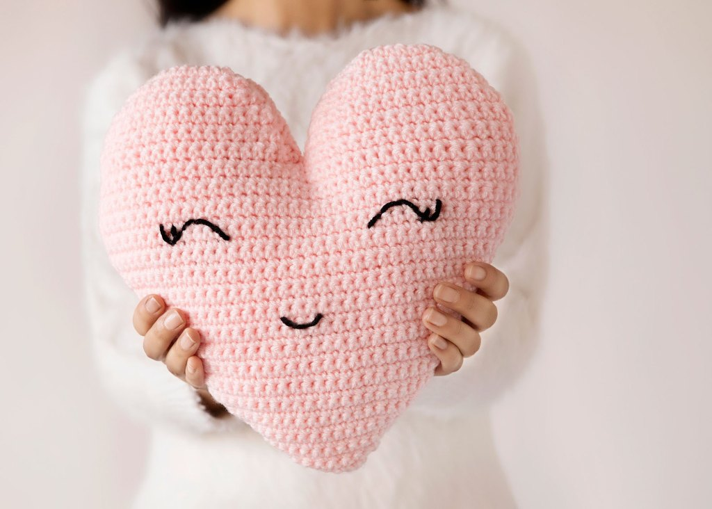 Heart-shaped Pillow - These crochet pillows are fun and an adventure to make. If you're looking for creative kids pillows, this list will be your go to. #CrochetPillowPatterns #CrochetPatterns #CrochetAddict
