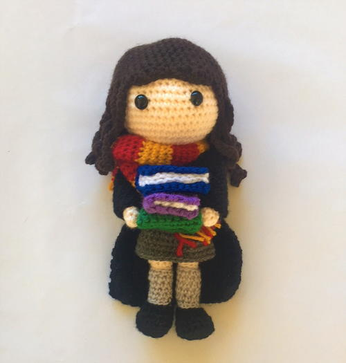 Hermione Granger Amigurumi - These free crochet doll patterns are a mix of amigurumi patterns and other techniques. Create your own world with dolls that will take you on a journey. #AmigurumiPatterns #CrochetDollPatterns #FreeCrochetPatterns