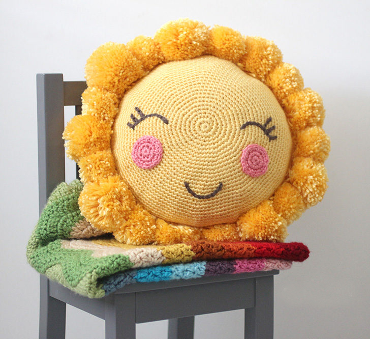 Pom Pom Sunshine Pillow - These crochet pillows are fun and an adventure to make. If you're looking for creative kids pillows, this list will be your go to. #CrochetPillowPatterns #CrochetPatterns #CrochetAddict