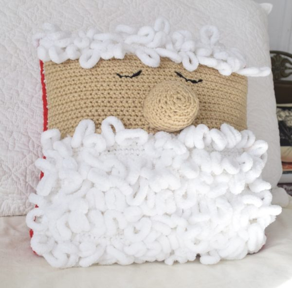 Sleepy Santa Pillow - These crochet pillows are fun and an adventure to make. If you're looking for creative kids pillows, this list will be your go to. #CrochetPillowPatterns #CrochetPatterns #CrochetAddict