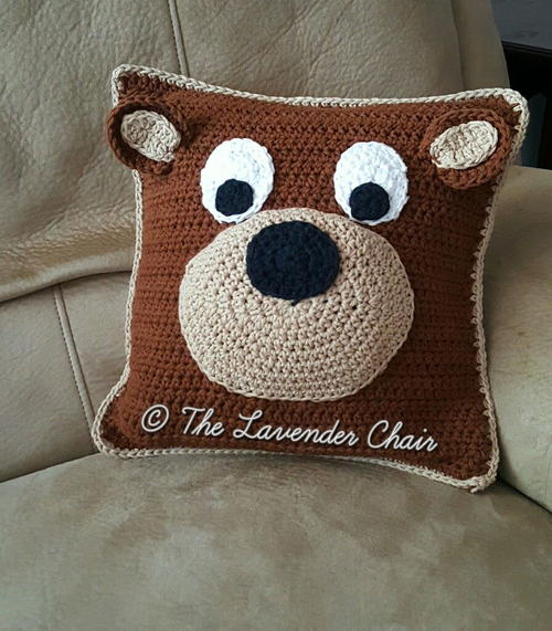 Teddy Bear Pillow - These crochet pillows are fun and an adventure to make. If you're looking for creative kids pillows, this list will be your go to. #CrochetPillowPatterns #CrochetPatterns #CrochetAddict