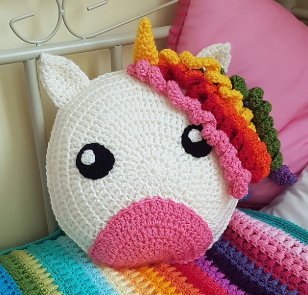 Unicorn Cushion - These crochet pillows are fun and an adventure to make. If you're looking for creative kids pillows, this list will be your go to. #CrochetPillowPatterns #CrochetPatterns #CrochetAddict