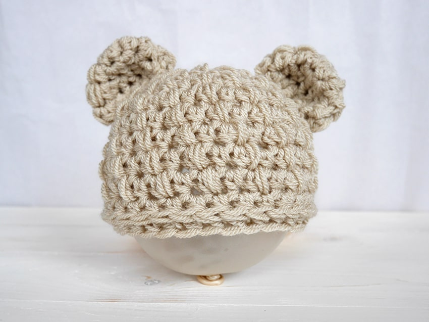 Baby Bear Hat - These free newborn crochet hat patterns are fun and easy to work on. These baby accessories are so fast to make and anyone can do it. #CrochetBabyHatPatterns #CrochetHatPatterns #CrochetNewbornHats