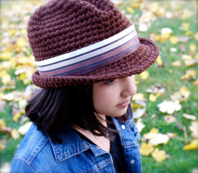 Classic Fedora - These free crochet hat patterns are perfect for sparking smiles and joy into a little child's life. Any excuse for fun is a good one in my book. #KidsCrochetHatPatterns #FedoraCrochetHat #CrochetHatPatterns #CrochetFedoraHat
