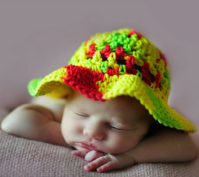 Coraline's Sun Hat - These free newborn crochet hat patterns are fun and easy to work on. These baby accessories are so fast to make and anyone can do it. #CrochetBabyHatPatterns #CrochetHatPatterns #CrochetNewbornHats