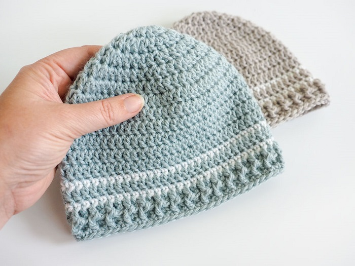 Easy Striped Baby Hat - These free newborn crochet hat patterns are fun and easy to work on. These baby accessories are so fast to make and anyone can do it. #CrochetBabyHatPatterns #CrochetHatPatterns #CrochetNewbornHats
