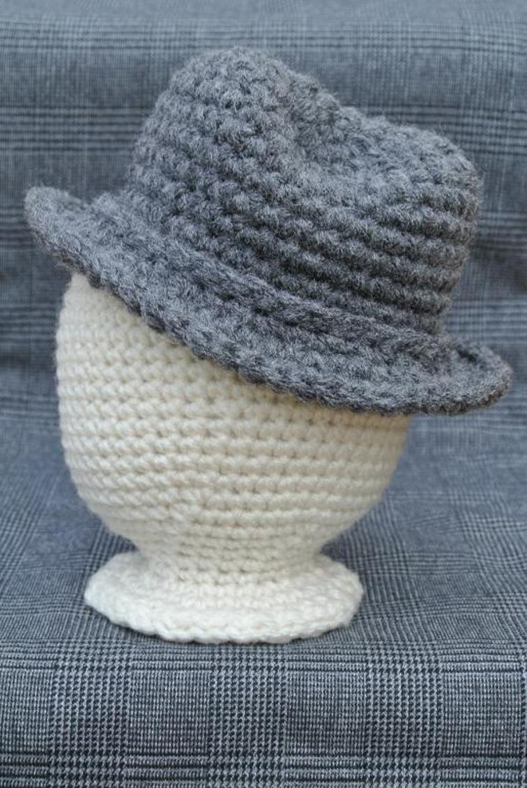 Newborn Fedora - These free crochet hat patterns are perfect for sparking smiles and joy into a little child's life. Any excuse for fun is a good one in my book. #KidsCrochetHatPatterns #FedoraCrochetHat #CrochetHatPatterns #CrochetFedoraHat
