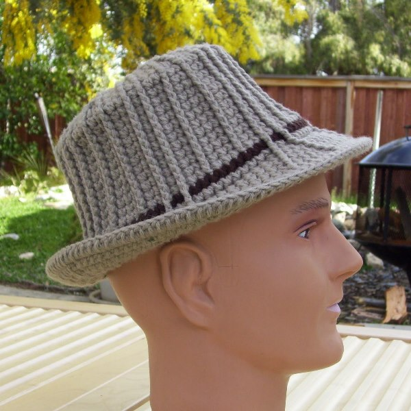 Unisex Ribbed Fedora - These free crochet hat patterns are perfect for sparking smiles and joy into a little child's life. Any excuse for fun is a good one in my book. #KidsCrochetHatPatterns #FedoraCrochetHat #CrochetHatPatterns #CrochetFedoraHat