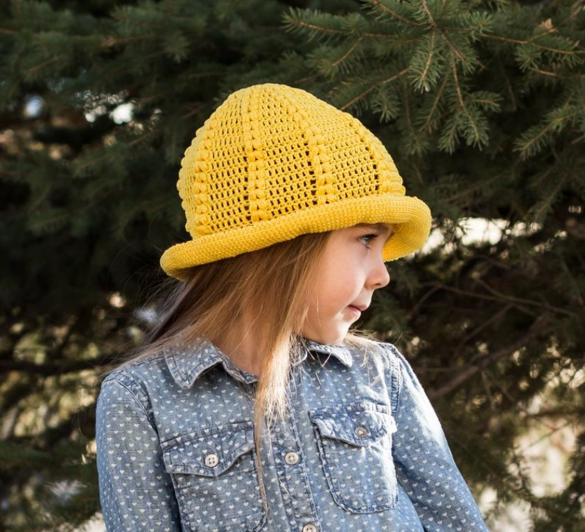 Daffodil Sunhat - All of these cute patterns are unique and come in a range of sizes. Pick a crochet hat pattern your kid will love and go with it. #SummerCrochetHat #CrochetPatterns #FreeCrochetHats