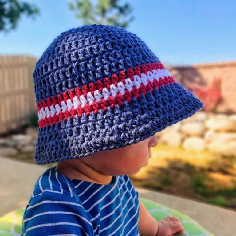 Sun and Sand Bucket Hat - All of these cute patterns are unique and come in a range of sizes. Pick a crochet hat pattern your kid will love and go with it. #SummerCrochetHat #CrochetPatterns #FreeCrochetHats