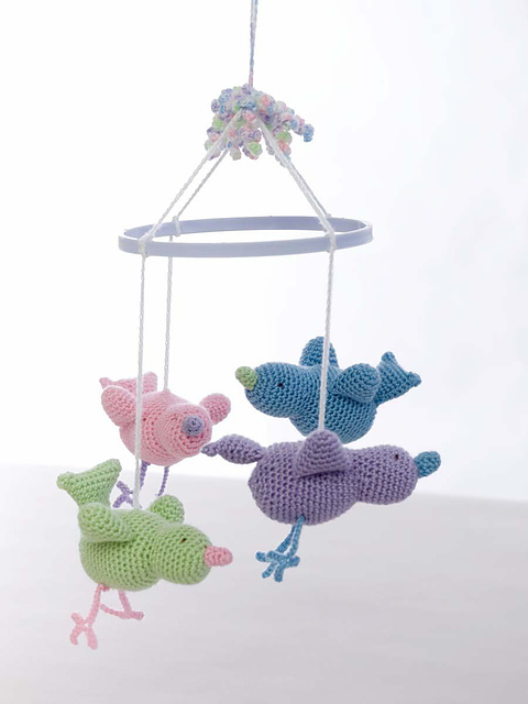 Baby Birdie Mobile - Crochet baby mobiles are colorful, fun and creative. Grab your hook and your favorite type of yarn, and get started on a baby mobile for someone you know. #CrochetBabyMobiles #CrochetPatterns #FreeCrochetPatterns