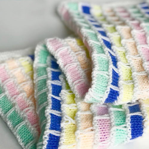 Brick and Mortar Baby Blanket - Each of these baby blanket knitting patterns is suitable for any skill level and is fun to make. The best part is how colorful they all are and how versatile. #BabyBlanketKnittingPatterns #KnitBabyBlankets #FreeKnitPatterns