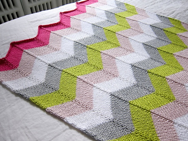Chevron Baby Blanket - Each of these baby blanket knitting patterns is suitable for any skill level and is fun to make. The best part is how colorful they all are and how versatile. #BabyBlanketKnittingPatterns #KnitBabyBlankets #FreeKnitPatterns
