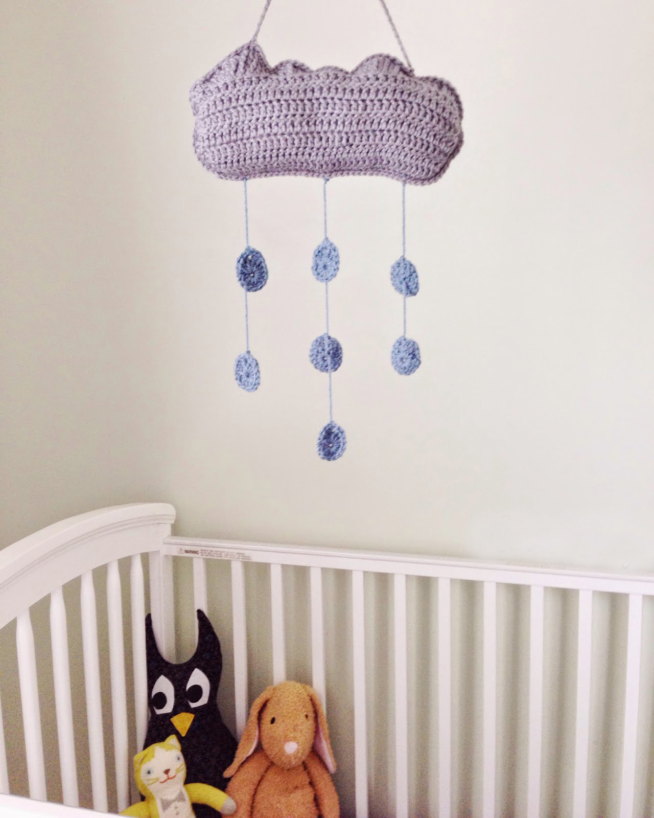 Clouds and Raindrops Nursery Mobile - Crochet baby mobiles are colorful, fun and creative. Grab your hook and your favorite type of yarn, and get started on a baby mobile for someone you know. #CrochetBabyMobiles #CrochetPatterns #FreeCrochetPatterns