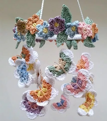 Butterfly and Flower Mobile - Crochet baby mobiles are colorful, fun and creative. Grab your hook and your favorite type of yarn, and get started on a baby mobile for someone you know. #CrochetBabyMobiles #CrochetPatterns #FreeCrochetPatterns