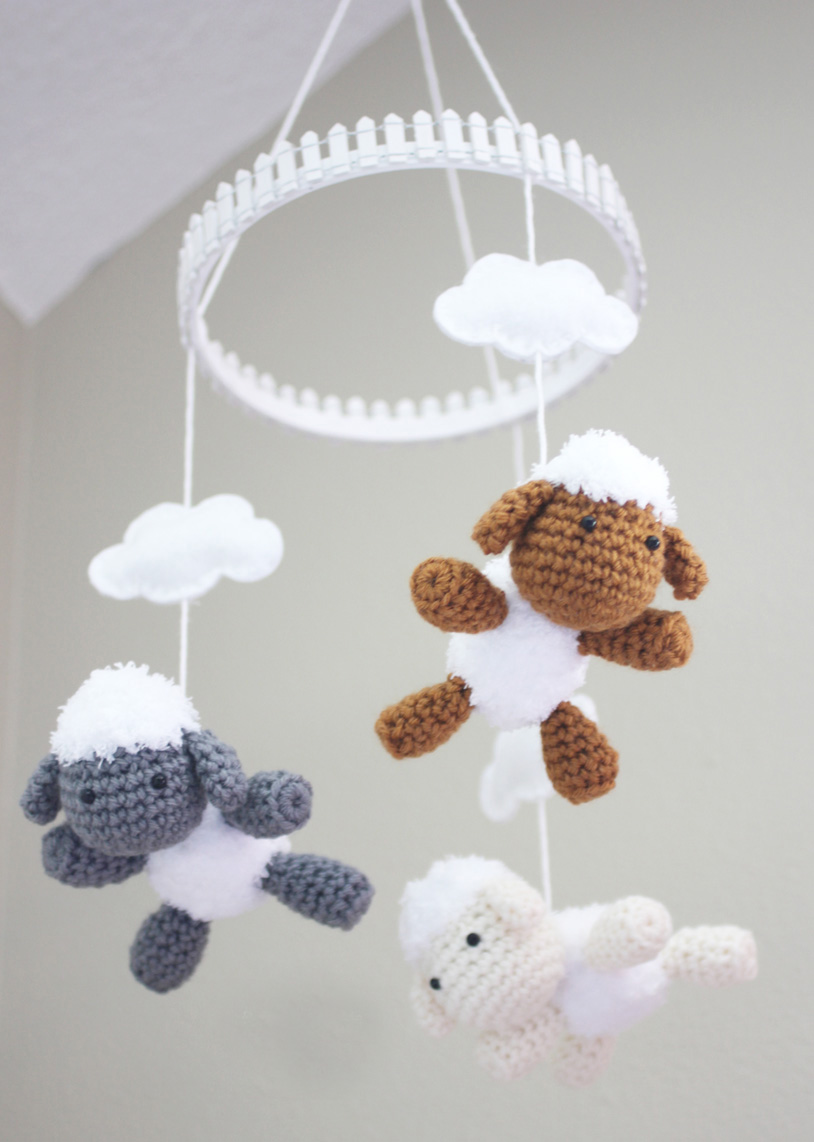 Lamb and Baby Mobile - Crochet baby mobiles are colorful, fun and creative. Grab your hook and your favorite type of yarn, and get started on a baby mobile for someone you know. #CrochetBabyMobiles #CrochetPatterns #FreeCrochetPatterns