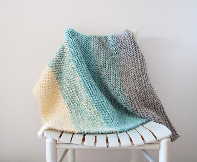 Easy Knit Baby Blanket - Each of these baby blanket knitting patterns is suitable for any skill level and is fun to make. The best part is how colorful they all are and how versatile. #BabyBlanketKnittingPatterns #KnitBabyBlankets #FreeKnitPatterns