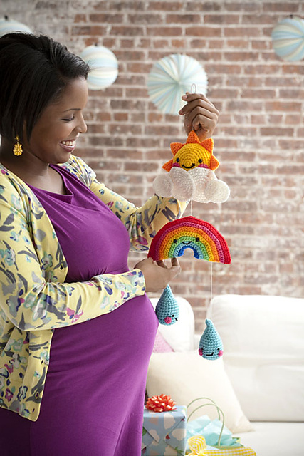 Happy Day Mobile - Crochet baby mobiles are colorful, fun and creative. Grab your hook and your favorite type of yarn, and get started on a baby mobile for someone you know. #CrochetBabyMobiles #CrochetPatterns #FreeCrochetPatterns