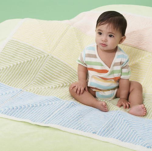 Pastel Stripe Baby Blanket - Each of these baby blanket knitting patterns is suitable for any skill level and is fun to make. The best part is how colorful they all are and how versatile. #BabyBlanketKnittingPatterns #KnitBabyBlankets #FreeKnitPatterns