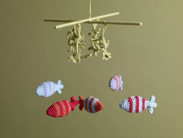 Undersea Crochet Mobile - Crochet baby mobiles are colorful, fun and creative. Grab your hook and your favorite type of yarn, and get started on a baby mobile for someone you know. #CrochetBabyMobiles #CrochetPatterns #FreeCrochetPatterns