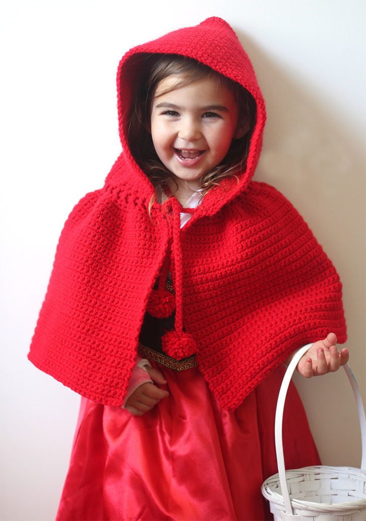 Crochet Little Red Riding Hood Cape - These hooded free crochet scarf patterns are excellent alternatives to full-blown costumes when your kid is not into that kind of thing. #freecrochetscarfpatterns #crochetscarf