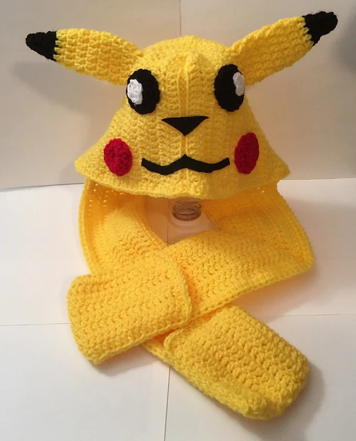 Pikachu Scoodie - These hooded free crochet scarf patterns are excellent alternatives to full-blown costumes when your kid is not into that kind of thing. #freecrochetscarfpatterns #crochetscarf