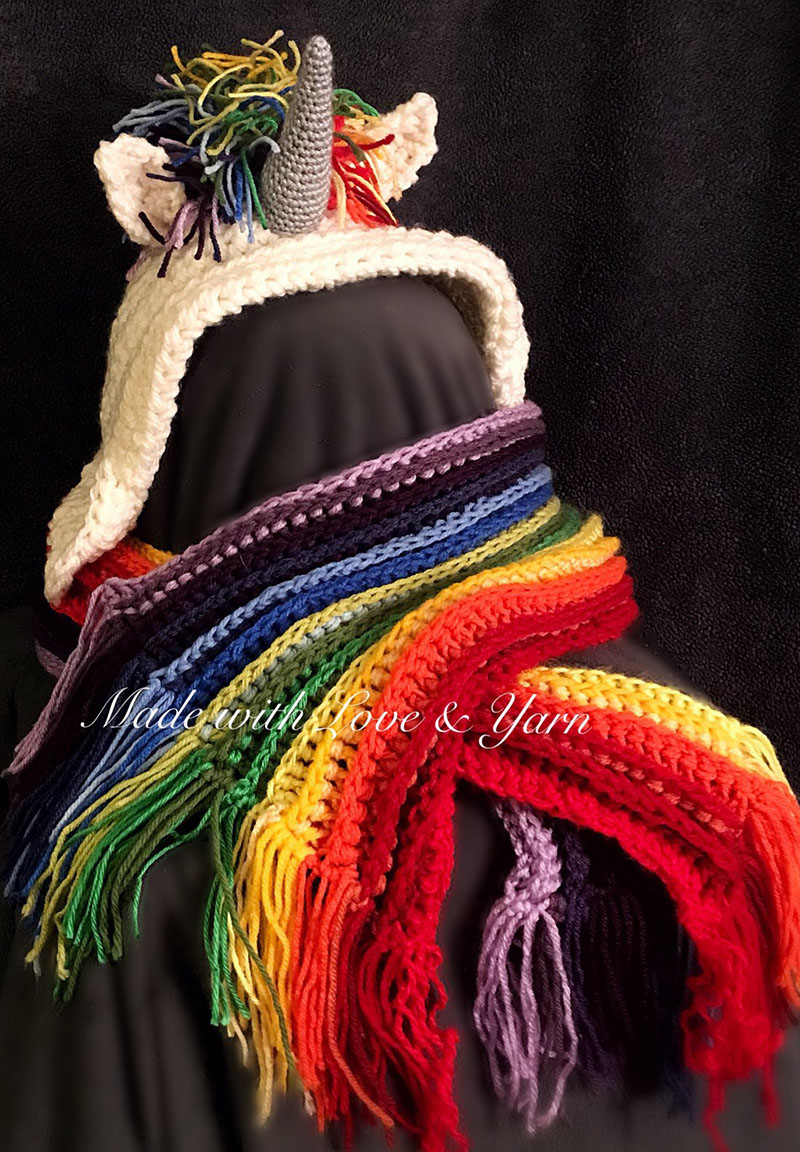 Rainbow Unicorn Hooded Scarf - These hooded free crochet scarf patterns are excellent alternatives to full-blown costumes when your kid is not into that kind of thing. #freecrochetscarfpatterns #crochetscarf