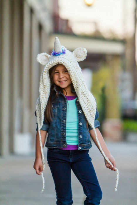 Unicorn Hood - These hooded free crochet scarf patterns are excellent alternatives to full-blown costumes when your kid is not into that kind of thing. #freecrochetscarfpatterns #crochetscarf