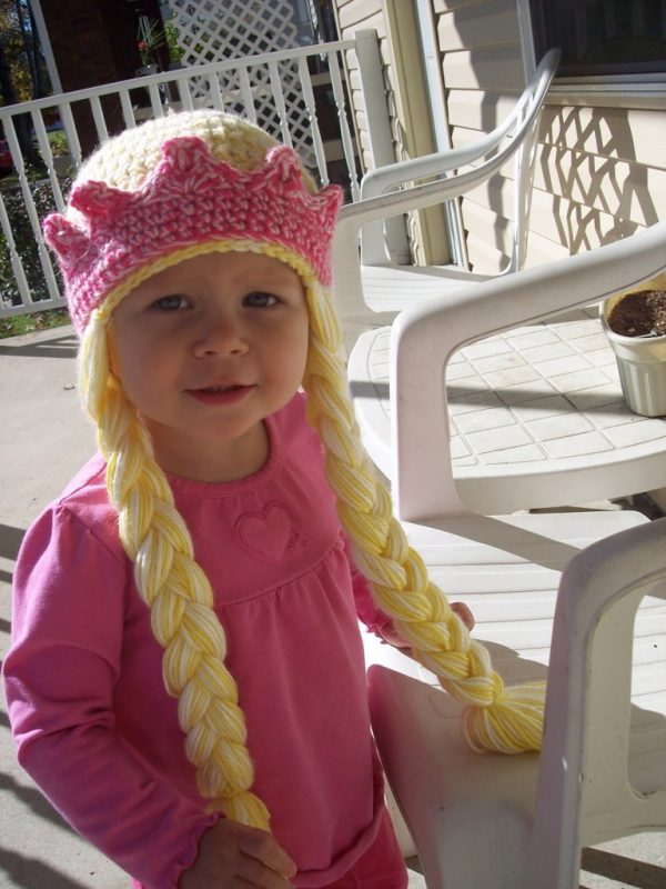 Beautifully Braided Princess Hat - If you're looking for something to wear for your children this Halloween, these 13 spooky crochet hat patterns for kids is a start. #kidscrochethat #crochethatpatterns #spookycrochethat