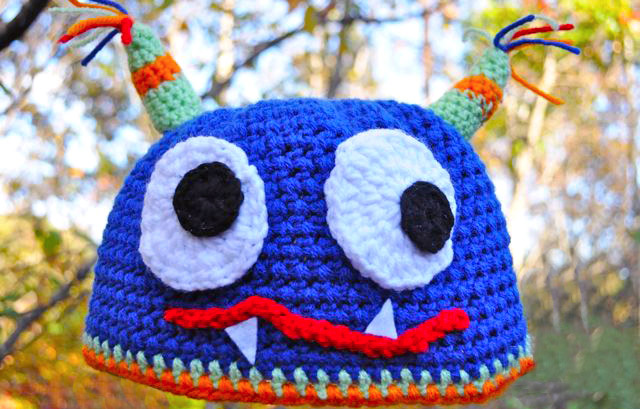 Crochet Monster Hat - If you're looking for something to wear for your children this Halloween, these 13 spooky crochet hat patterns for kids is a start. #kidscrochethat #crochethatpatterns #spookycrochethat