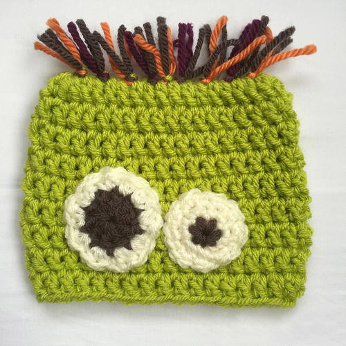 Scared Silly Monster Baby Hat - If you're looking for something to wear for your children this Halloween, these 13 spooky crochet hat patterns for kids is a start. #kidscrochethat #crochethatpatterns #spookycrochethat